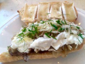 Venison Tenderloin, homemade sauerkraut, Brie, fresh herbs, garlic toum