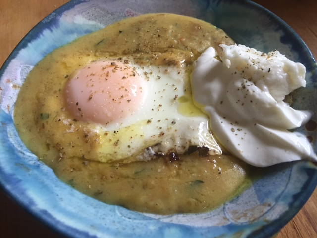 Creamy potato soup topped with over easy egg and a dollop of Greek yogurt/garlic toum
