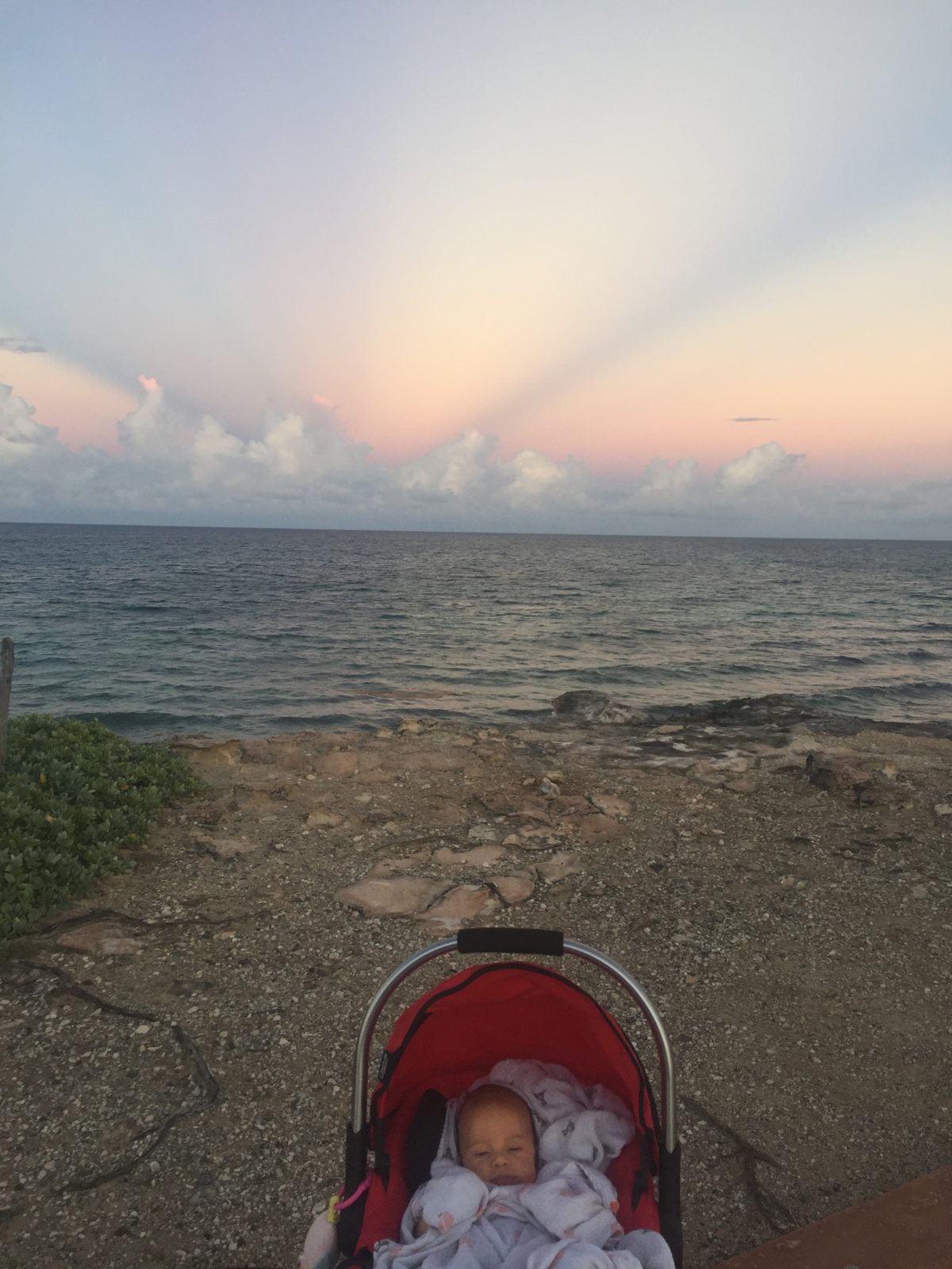 Baby Callan and an Isla Mujeres sunset.